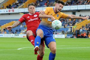 Mansfield Town v Accrington Stanley.'Mansfield's second penalty is awarded after this challenge in the first half.