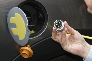 Embargoed to 0001 Monday July 09 File photo dated 26/03/10 of an electric car being charged up, as plans aimed at making it easier to recharge electric vehicles than refuel petrol or diesel models will be announced by the Transport Secretary.