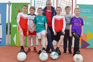 John McGovern passes on some tips to Cotmanhay Junior School pupils.