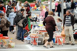 Bargain-hunters search a second-hand market (REMY GABALDA/AFP/GettyImages)