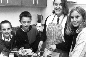 Pupils at Aldercar School take part in an after-school cooking class in the early 1990s.