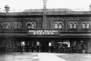 The front of Chesterfield's Midland Railway Station, completed with horse-drawn carriages waiting outside