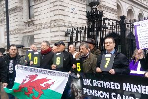 Former miners outside 10 Downing Street after handing over a 100,000 name petition.