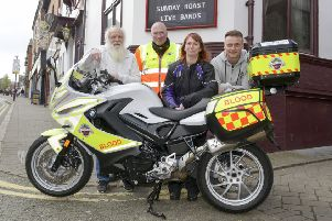 The New Inn at Ilkeston raising money for Derbyshire Blood Bikes in memory of customer Jamie Henshaw'publican Ken Harrison has grown his hair and beard for a year, pictured with Mark Vallis (blood Bike co-ordinator), Jamie's wife, Lisa and son Julian
