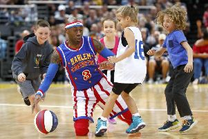 Firefly of the Globetrotters plays tricks with some kids.  Photo by Daniel Munoz/Getty Images.
