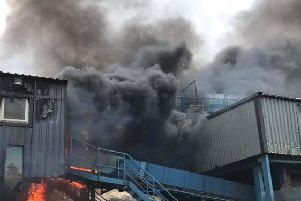 The fire tore through an industrial unit on the Quarry Hill estate.