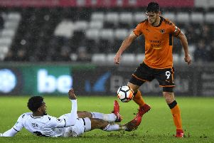 SWANSEA, WALES - JANUARY 17:  Leroy Fer of Swansea City tackles Rafa Mir of Wolverhampton Wanderers  during The Emirates FA Cup Third Round Replay between Swansea City and Wolverhampton Wanderers at Liberty Stadium on January 17, 2018 in Swansea, Wales.  (Photo by Stu Forster/Getty Images)