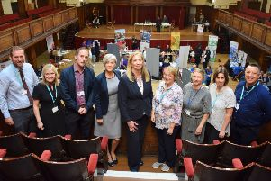 Members of the Lancashire Adult Learning team (left and right) flanking representatives from Jobcentre Plus in Lancaster and Morecambe and members of the economic development team at Lancaster City Council.