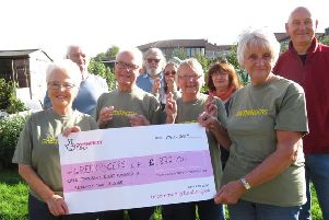 Daisy Bank allotment users celebrating after receiving a cheque for �1872 from the National Lottery fund. The money was used to replace a compost toilet on the allotments.