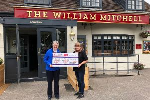 Rosemere Cancer Foundation's Julie Hesmondhalgh (left) receives this year's fun day donation from The William Mitchell's landlady Tricia Ulyatt.