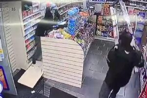 The store worker fends off the raiders with step ladders
