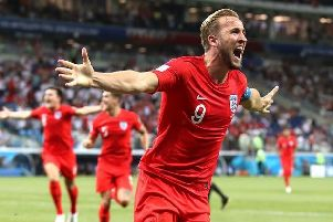 England captain Harry Kane celebrates his second goal to earn the Three Lions victory against Tunisia