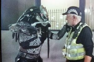 Police officer and 'Predator' squaring off