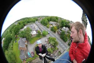 Bishop Philip North abseiled down the outside of St Johns Church tower in Whittle-le-Woods, near Chorley in 2015