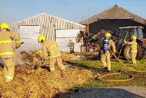 Firefighters tackling the barn fire