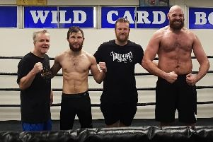 Isaac Lowe, second left, with Freddie Roach, Ben Davison and Tyson Fury