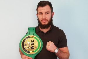 Isaac Lowe with his WBC International featherweight title