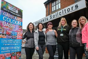 The Vincents Solicitors team prepares for the Garstang Colour Dash, with Zosia Muhler from St John's Hospice.