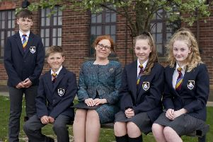 Morecambe Bay Academy Principal Victoria Michael with pupils wearing the new uniform