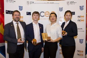 The Lancaster University team of (from second left) Dan Ashton, Aura Zhao and Yang Du, with Simon Harrison, Enterprise Programme Manager for Lancaster University, after winning the Bronze Award.