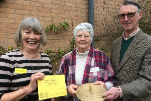 Bronwen and Peter Osborne receive their sundial from Lancashire County Organiser Margaret Fletcher (left).