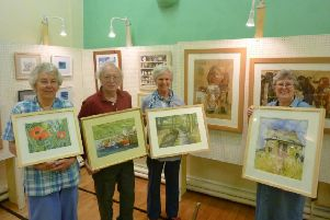 Clapham Art Group's annual exhibition will be open 11am-6pm every day until June 2 in the village hall.'As well as pictures in a wide variety of media and subjects, there will be mounted folder pictures, sketches and cards for sale.'From left: members Liz Smart, John Richards, Margaret Blackburne, and leader Linda Clemence.