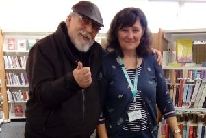 Poet Bryan Griffin with an assistant at Heysham library which is hosting poetry and acoustic open mic nights starting in July.