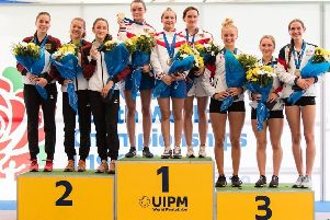 Emma Whitaker, third from the right, on the podium after winning team bronze at the modern pentathlon World Under-19s Championships.
