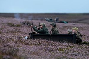 A shooting party enjoy the start of the grouse shooting season