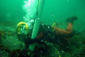 Diver operating an underwater airlift.