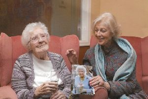 Marjorie Dawson celebrating her 100th birthday with Princess Alexandra, who is holding a card from the Queen.