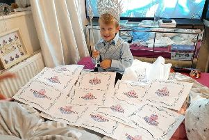 Jayden Fox with all his winning certificates from the Miss Britannia Crystal Master section.