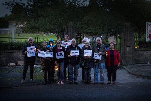 Councillors hold a vigil outside the now closed Skerton High School