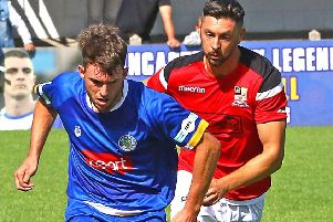Rob Wilson on the attack for Lancaster City. Picture: Tony North