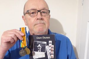 Atherton actor Dave Dutton with his book The Thirty Bob Kid and his grandad Herbert's war medals