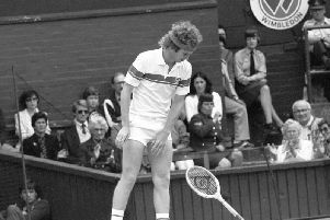 John McEnroe throwing his racket in anger during his stormy semi-final match against Australian Rod Frawley