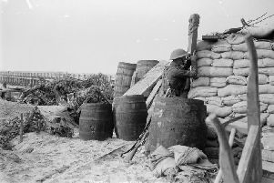 Officer of 2/4th East Lancashires observes the enemy through a trench periscope