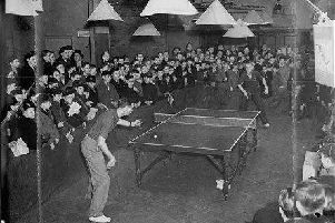 This photograph illustrates the popularity of table tennis in 1948