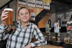 Christine Lamb serves a pint of ale at new bar Sherringtons