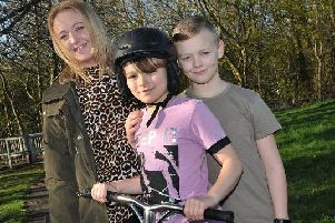 Joshua Wallwork with his mum Stacey and older brother Aaron