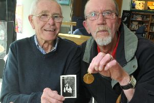 John and Bill Shepherd with the medal