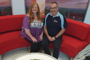 Francesca Lowe on the red sofa with Steve Carter