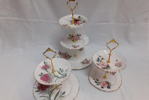These ceramic tiered cake stands are decorated attractively with flowers