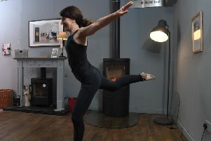 Suzanne Astley takes a break from the family business to demonstrate her dance skills in the showroom
