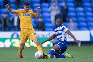 Preston left-back Andrew Hughes is challenged by Reading's Yakou Meite
