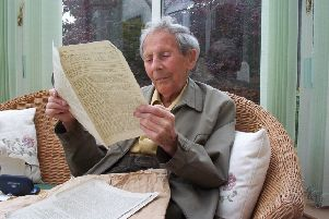 Vegan Society co-founder Donald Watson leafing through an early copy of The Vegan News.
