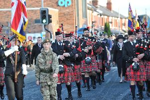 A band of pipers trumpeted Lostock Hall's Remembrance parade.