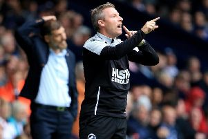 Ex-Millwall boss Neil Harris is still the bookies' favourite to land the vacant Cardiff City job, but ex-Brighton boss Chris Hughton's odds are notably shortening.