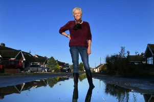 Kate Walker, 69, said her garden turns into a 'swamp' every time it rains due to blocked drains in her Hutton street