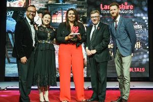 Professional ice-skater Daniel Whiston (left) presenting an award to Golden Ball of Longton's Emma Golpys, Victoria Duffy and pub owner Chris Buckley (far right). They are pictured with John Gillmore of BBC Radio Lancashire (second right).